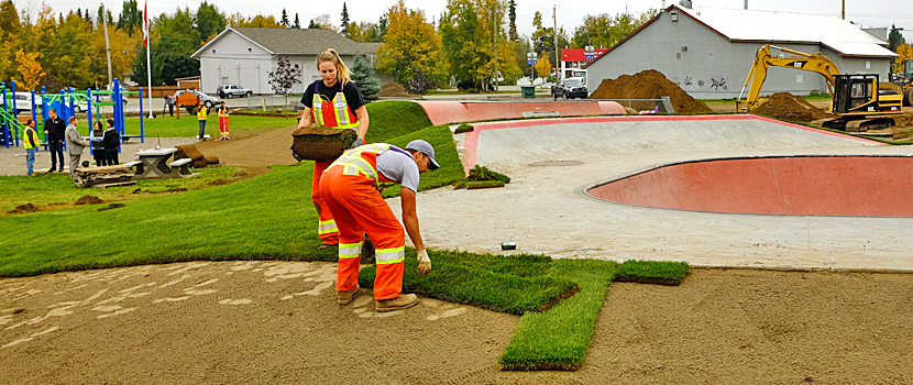 City Workers lay sod at the Hart Skate Park located at the Darren Fitzpatrick Bravery Park