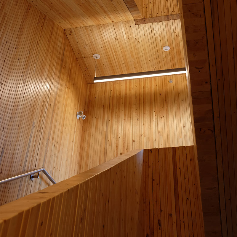 The new fire hall features engineered wood construction. The main stairway was built using 3,000 pieces of lumber.