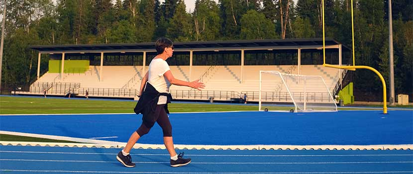 Woman walking at Masich Place Stadium track
